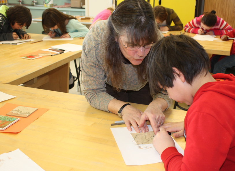 Mary working with a student.